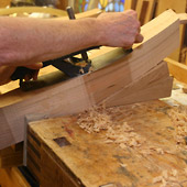 Hand shaping of St. Joseph Presider Chair Arm